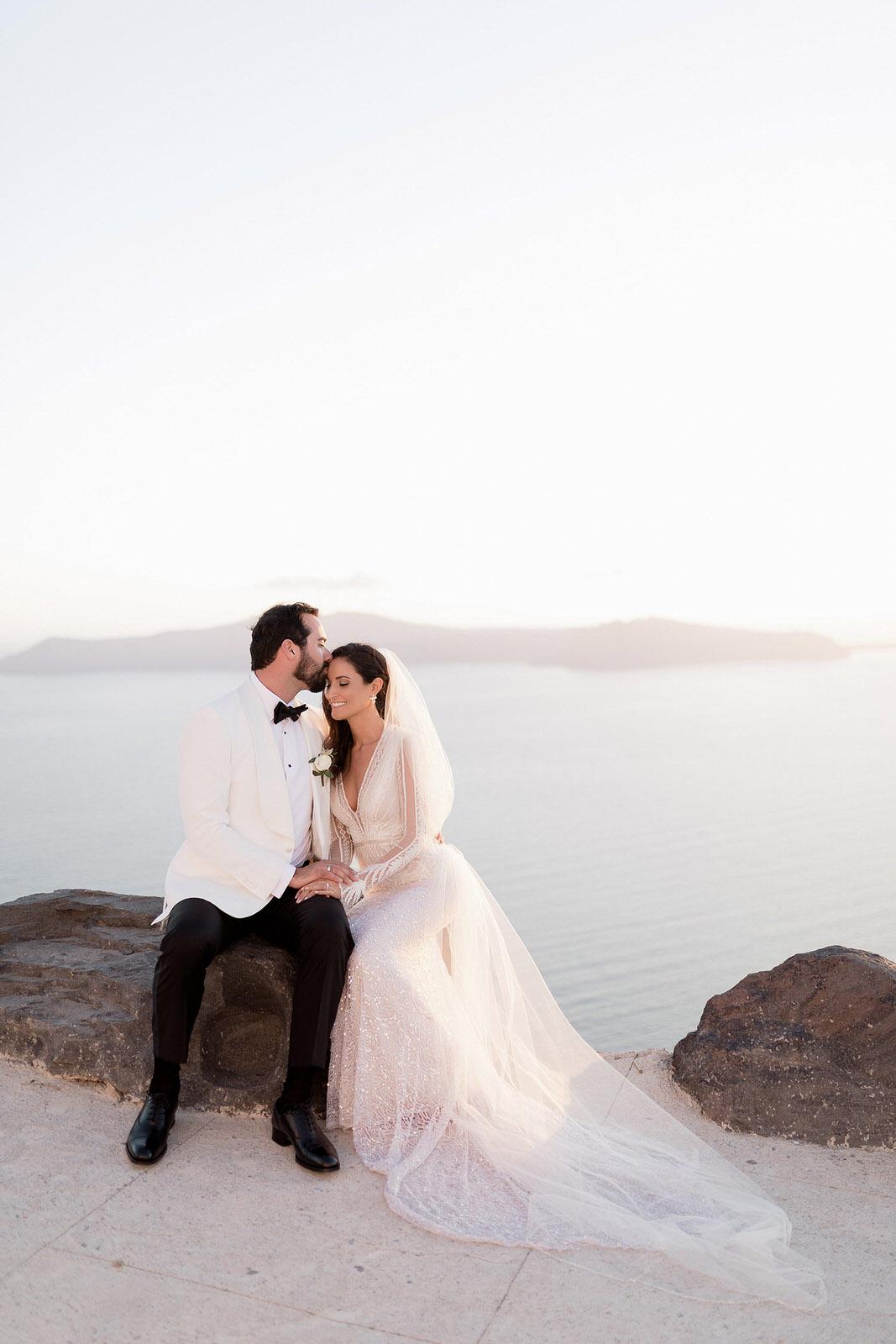 bride and groom kissing on their wedding in santorini